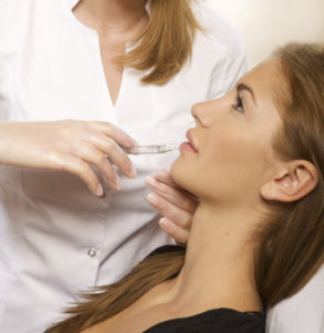 beautiful woman having an injection